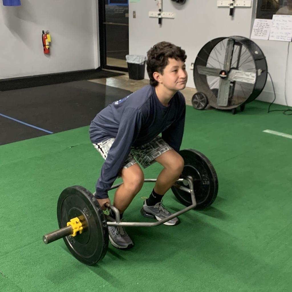 Nolan Mayer deadlifting at the gym